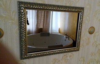 26 and 27 inch Magic Mirror TVs decorated with classic design frame in a SPA salon